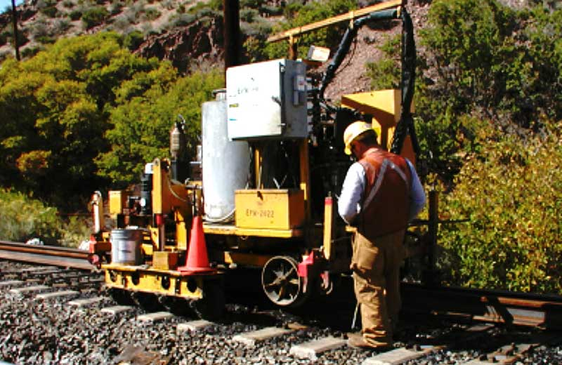 Encore Rail Systems walk behind tie plugger